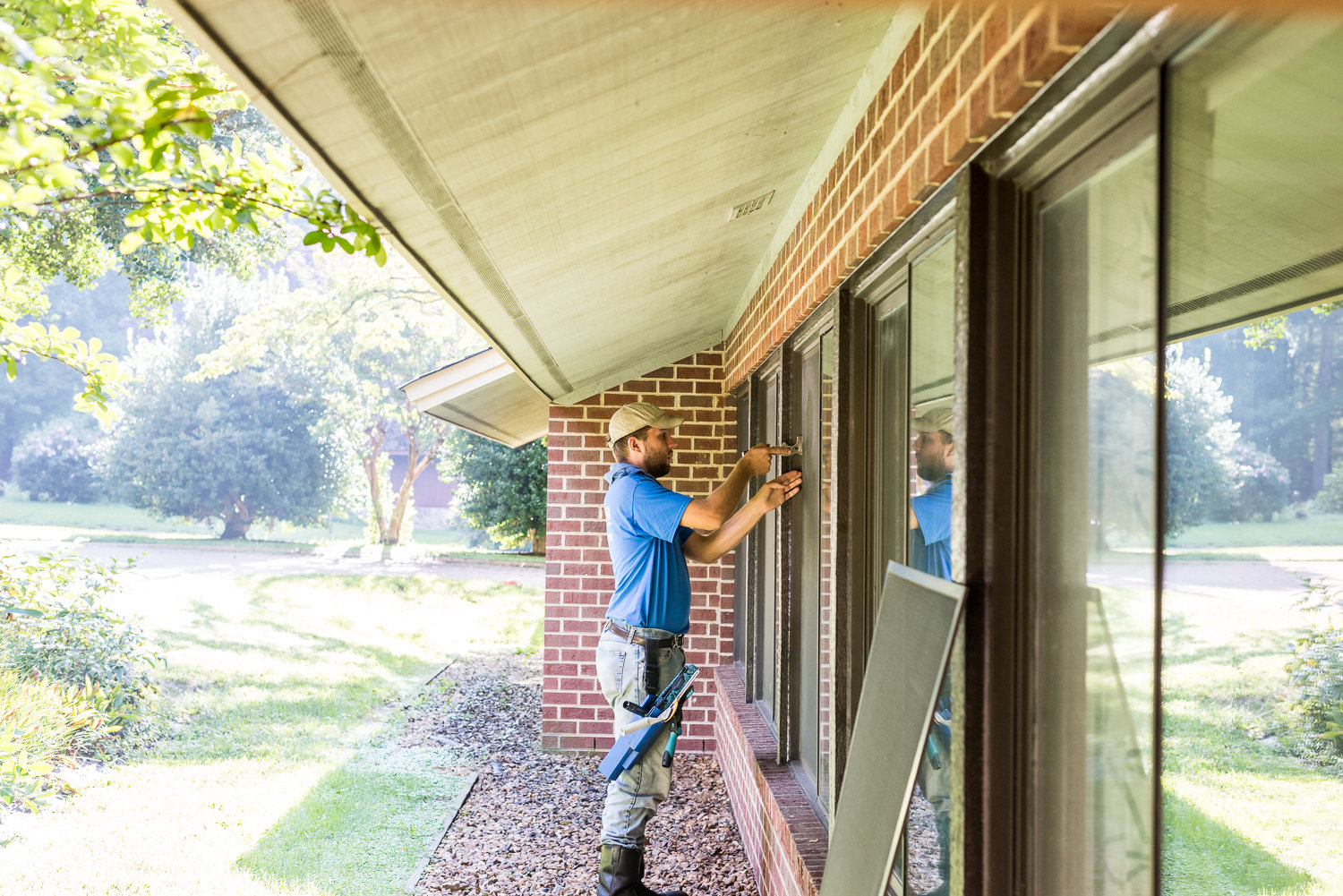 Our crew adding a screen to a window in Richmond, VA.