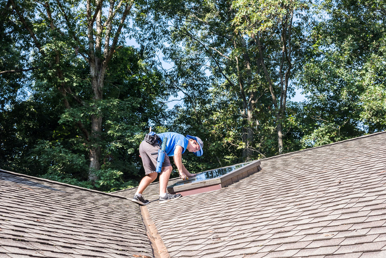 Crew cleaning a sky window on roof in Richmond, VA.
